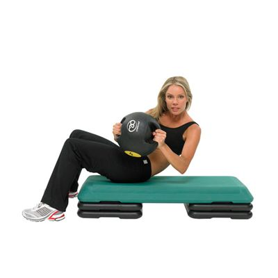 Fitness Mad 4kg Double Grip Medicine Ball In Use Image 1